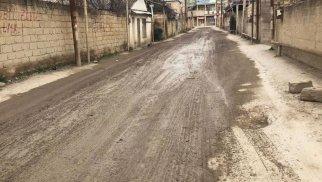Abşeronda 6 ay əvvəl asfaltlanan yol dağıldı - FOTOLAR